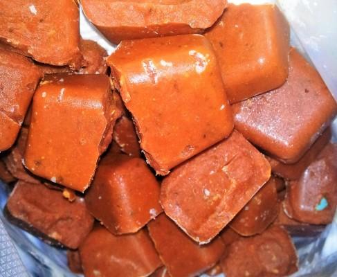 Frozen cubes of pizza sauce