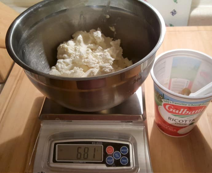 Ricotta cheese and sugar being weighed on a Baker's Math Kitchen Scale