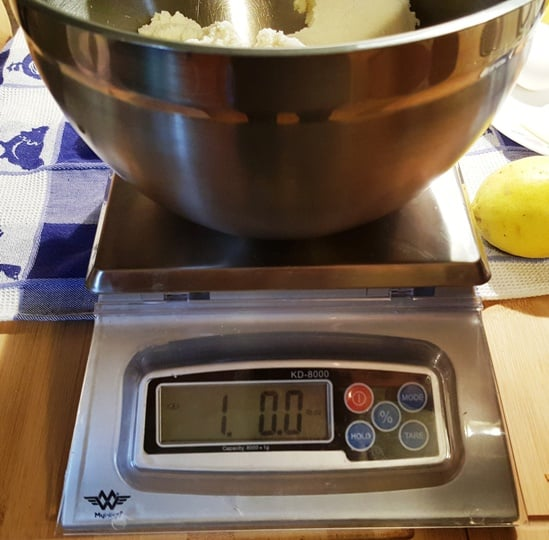 Weighing ricotta cheese on a Baker's Math Kitchen Scale
