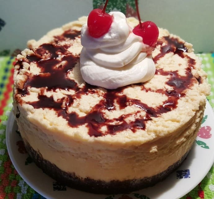 A Pressure Cooker Happy Birthday Brownie Cheesecake on a plate