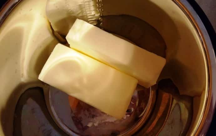Add Butter to the Pressure Cooker Cooking Pot