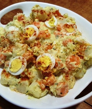 A plate of Instant Pot Potato Salad with Carronts on a table