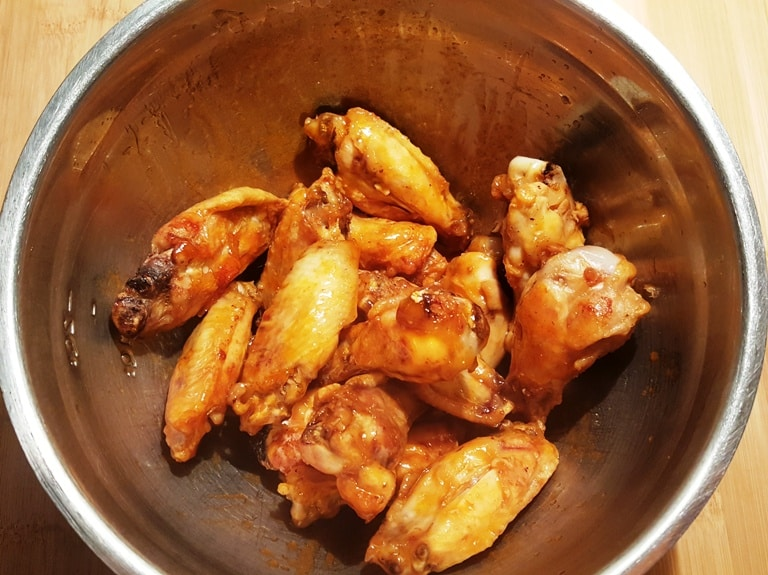 Combine the Hot Wing Sauce with Crispy Chicken Wings