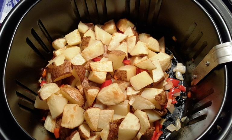 Home fried potatoes in an Air Fryer basket