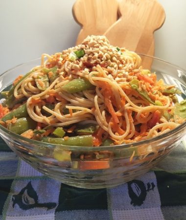 An Asian Noodle Salad bowl with snap peas, carrots, peppers and a peanut butter dressing