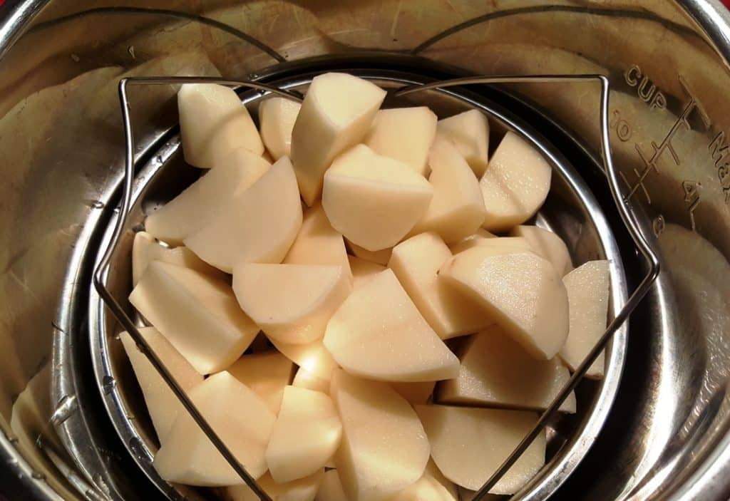 Peeled and Quartered Russet Potatoes in a Steaming Tray