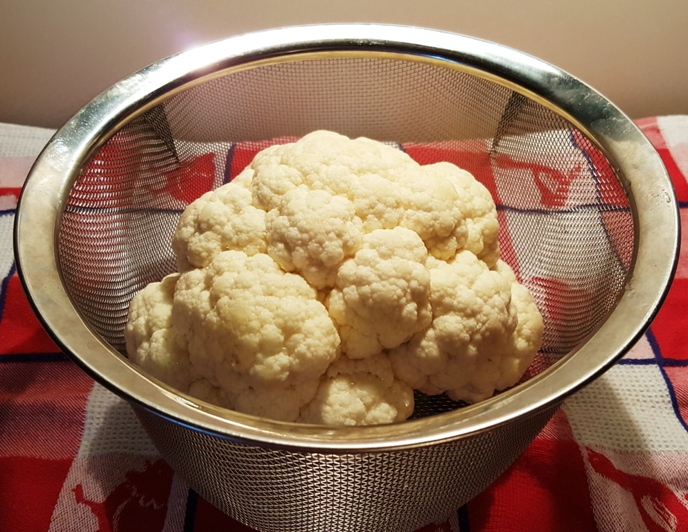 Place Cauliflower in Steamer Basket or on Trivet