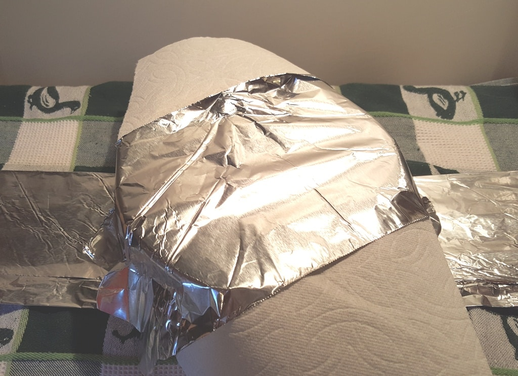 Lightly place a paper towel and foil
