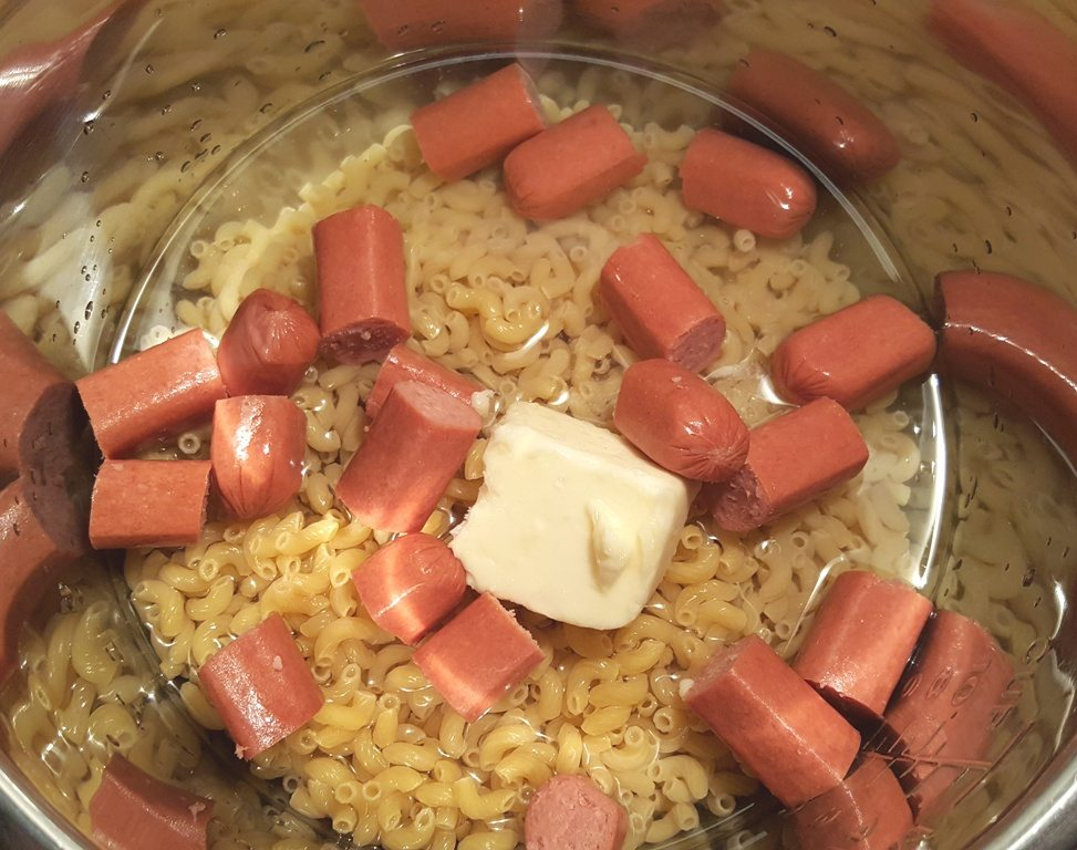 Add cut up Hot Dogs, if desired