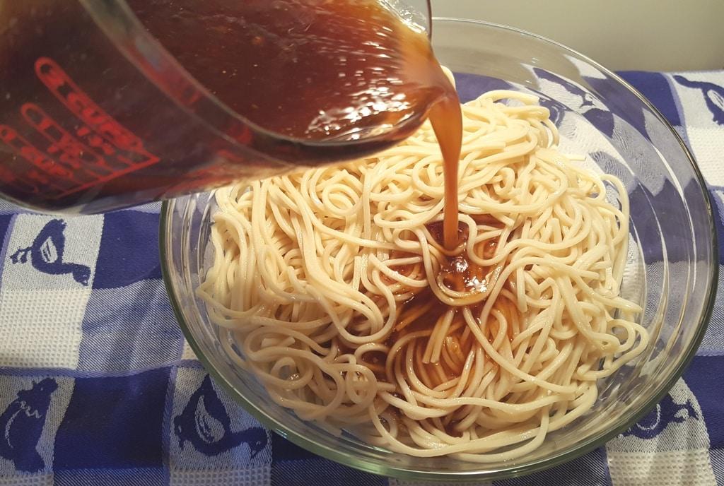 Pour the Sesame Noodle Sauce on the Noodles