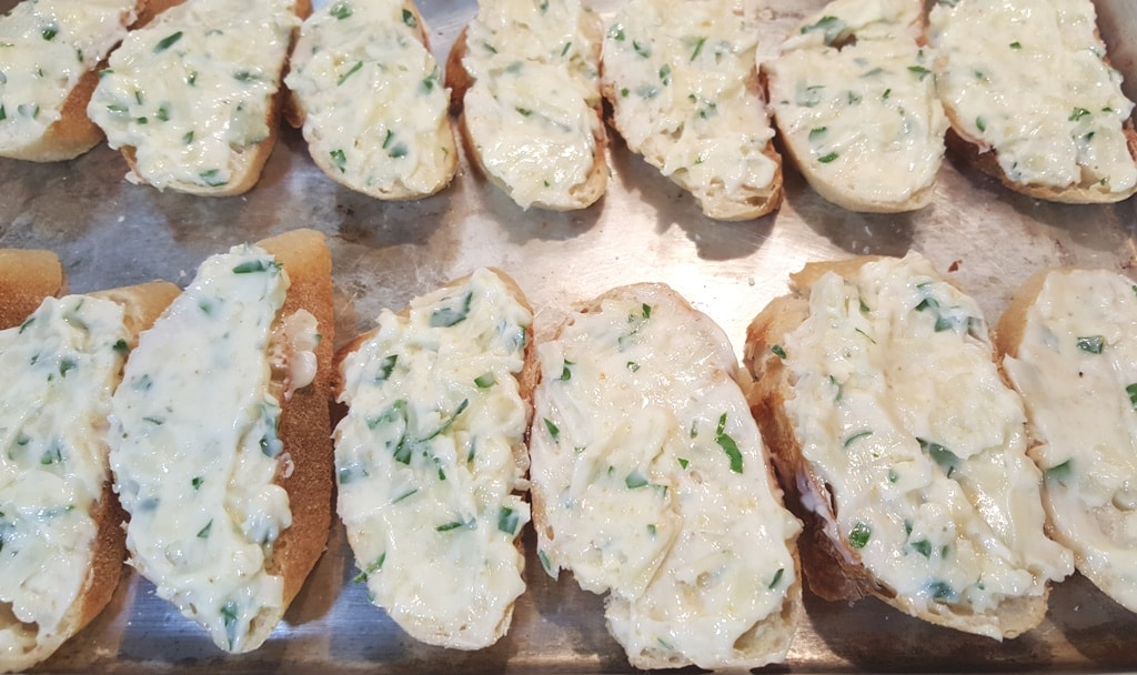 Spread the Garlic Parmesan Butter Mixture onto the Baguette Slices