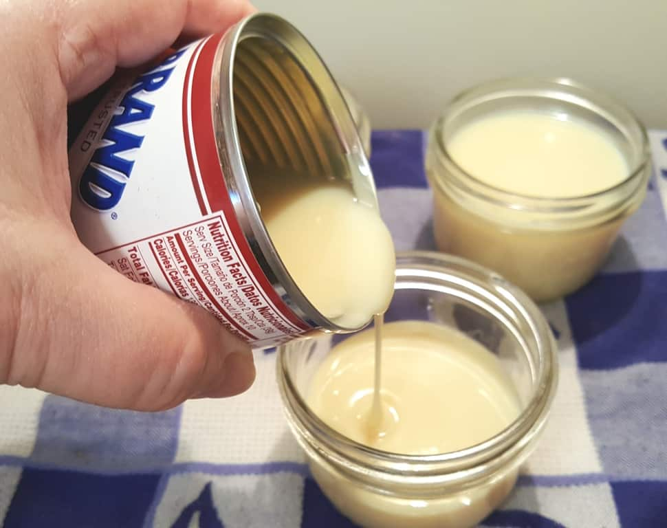 Pour Sweetened Condensed Milk into Mason Jars