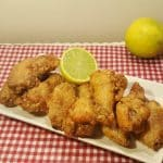 Air Fryer Crispy Old Bay Chicken Wings with a slice of Lemon