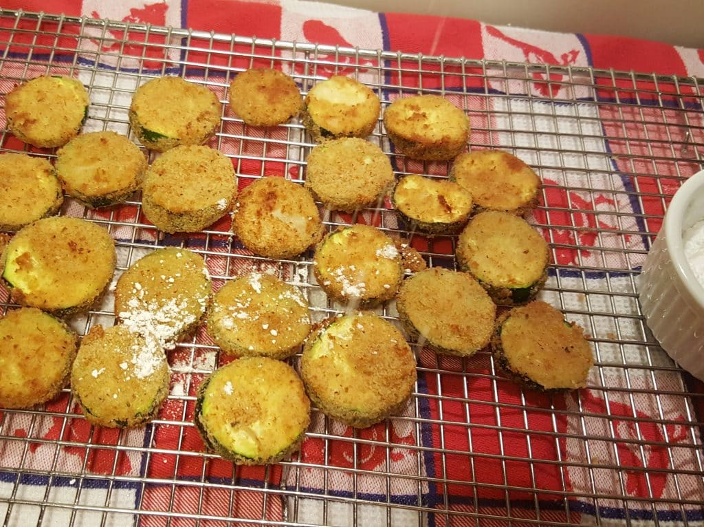 Sprinkle the Air Fryer Zucchini Zircles with Powdered Sugar