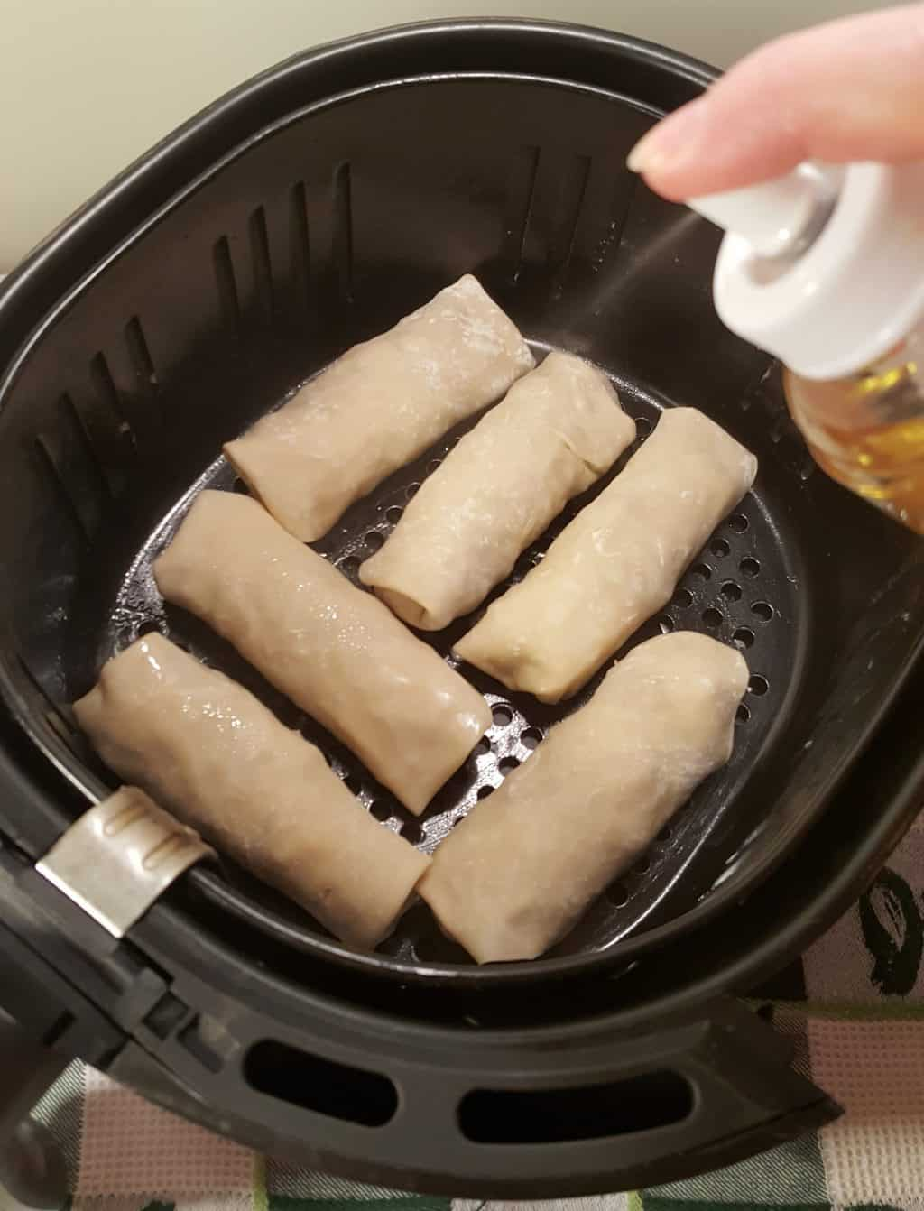 Place Egg Rolls in Greased Air Fryer