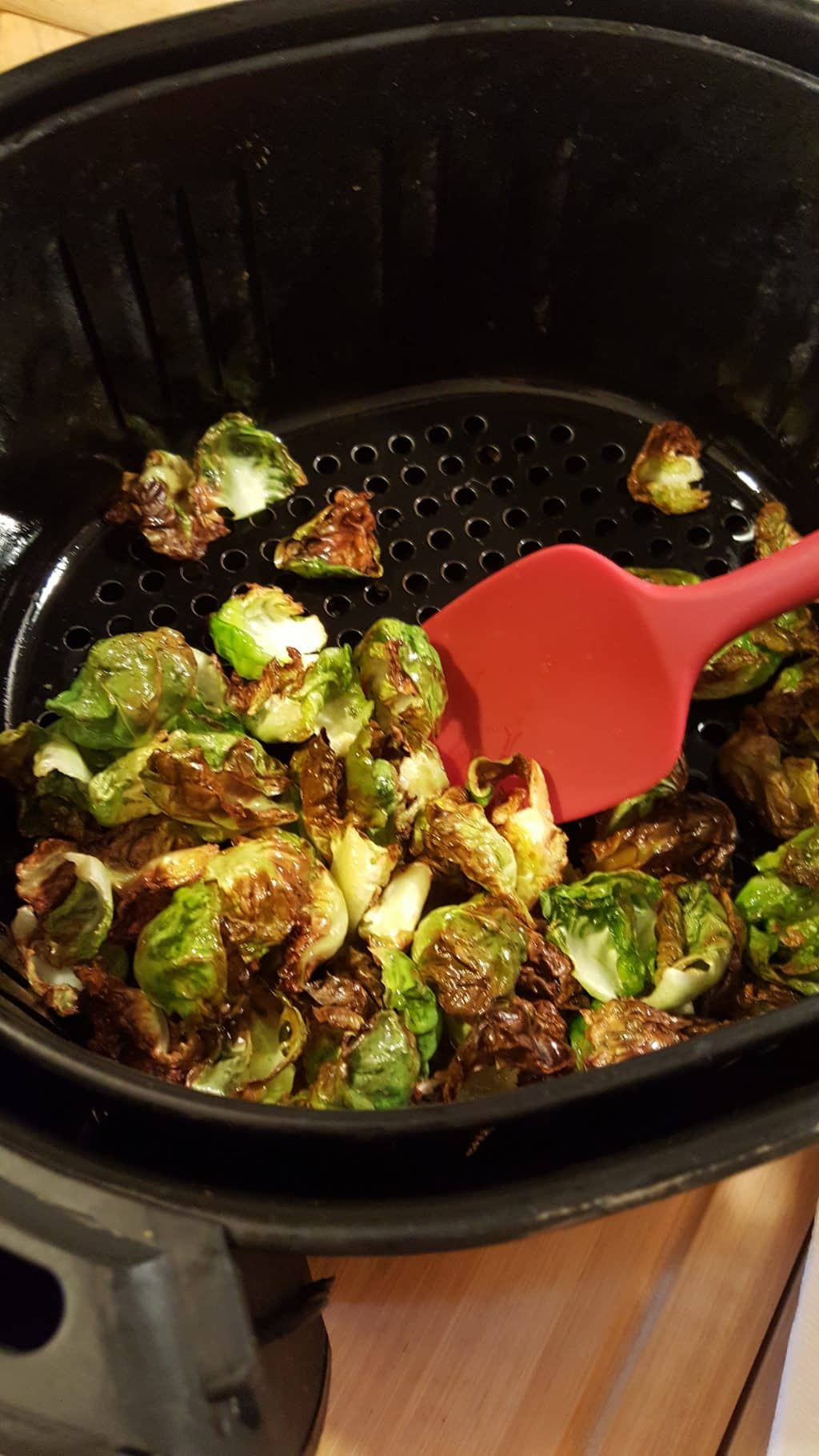 Remove Brussels Sprouts from Air Fryer