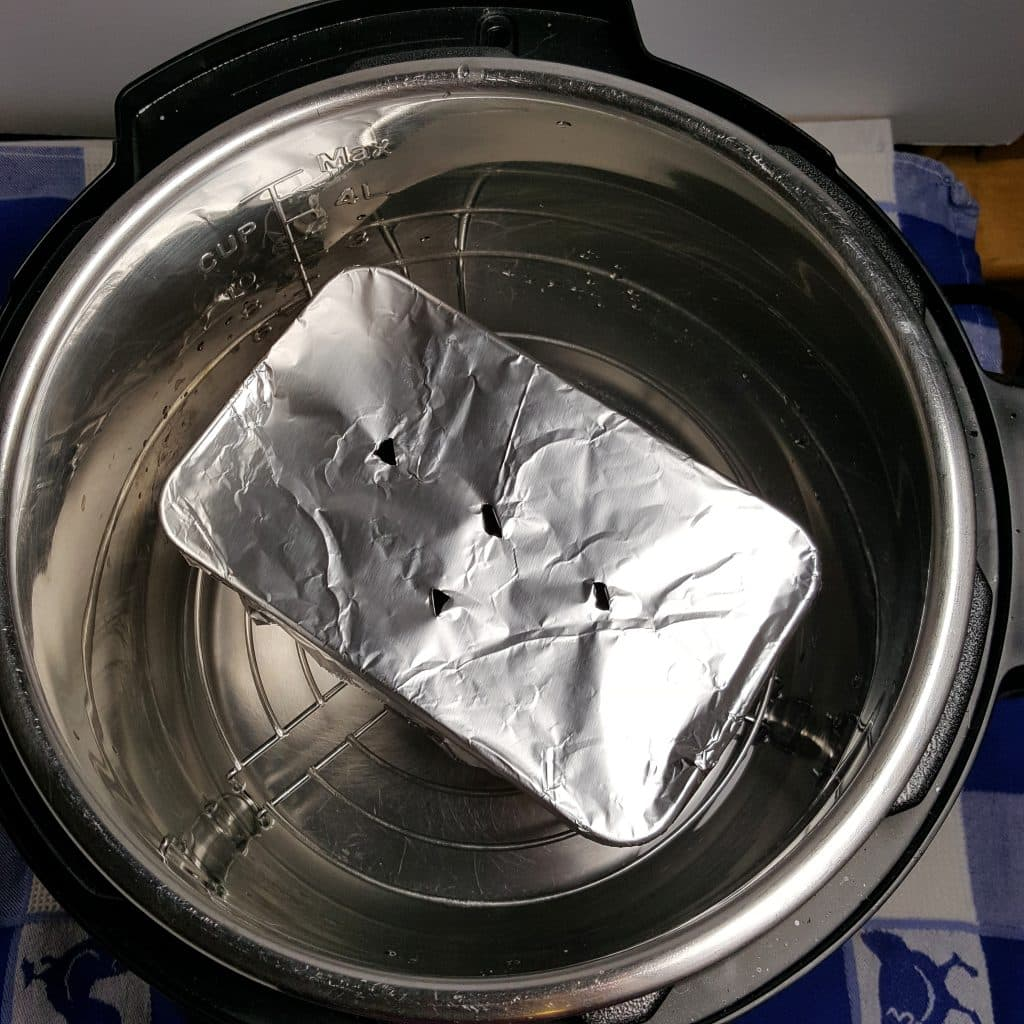 Place Loaf Pan into Pressure Cooker Cooking Pot