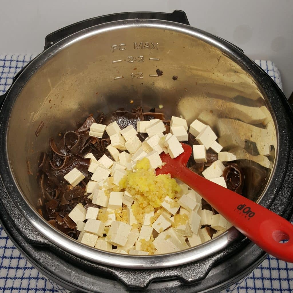 Add Mushrooms, Lily Flowers Tofu, Garlic, Ginger to Pressure Cooker
