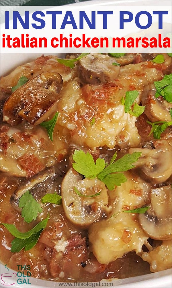 A bowl of Italian chicken marsala (chicken and mushrooms) in an oval white plate with parsley garnish on top.