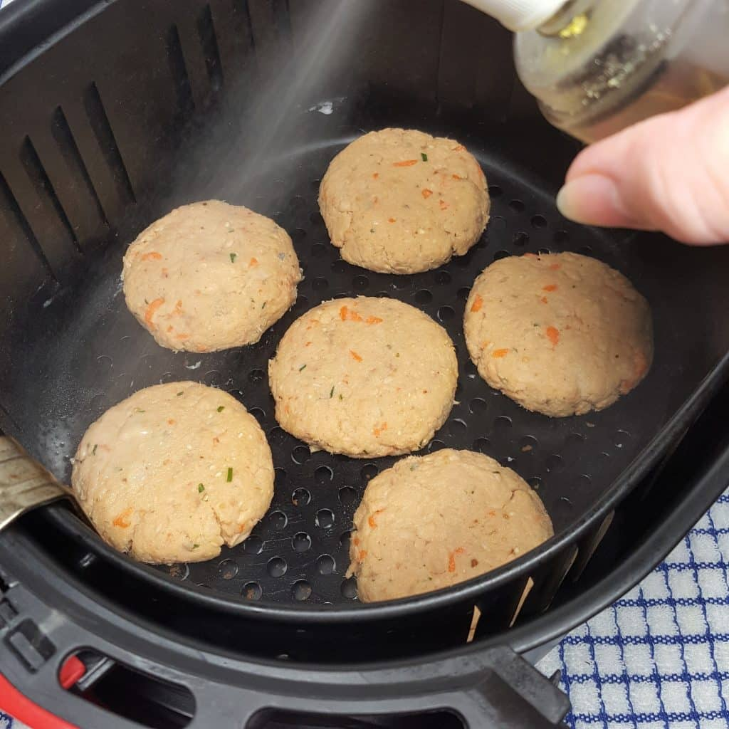Generously Spray the Croquettes with Olive Oil
