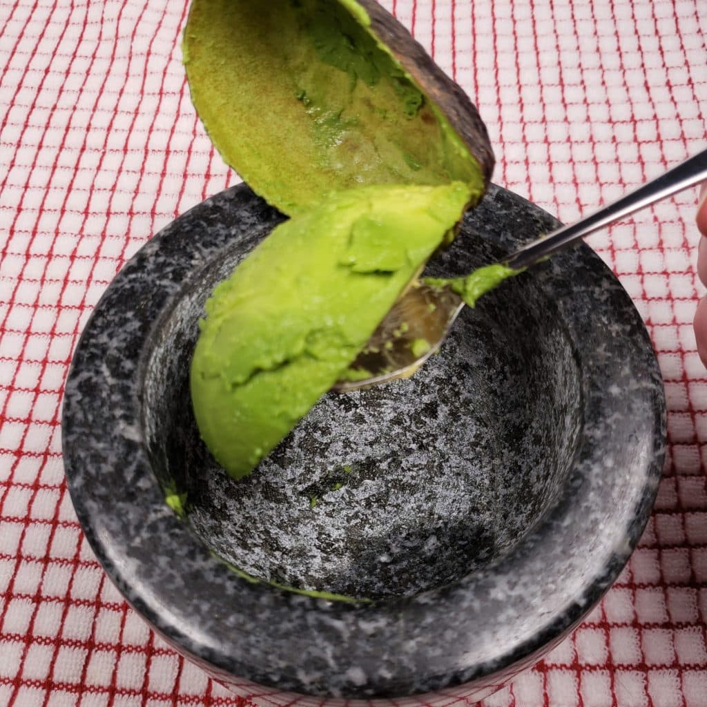 Scoop Avocado into Molcajete