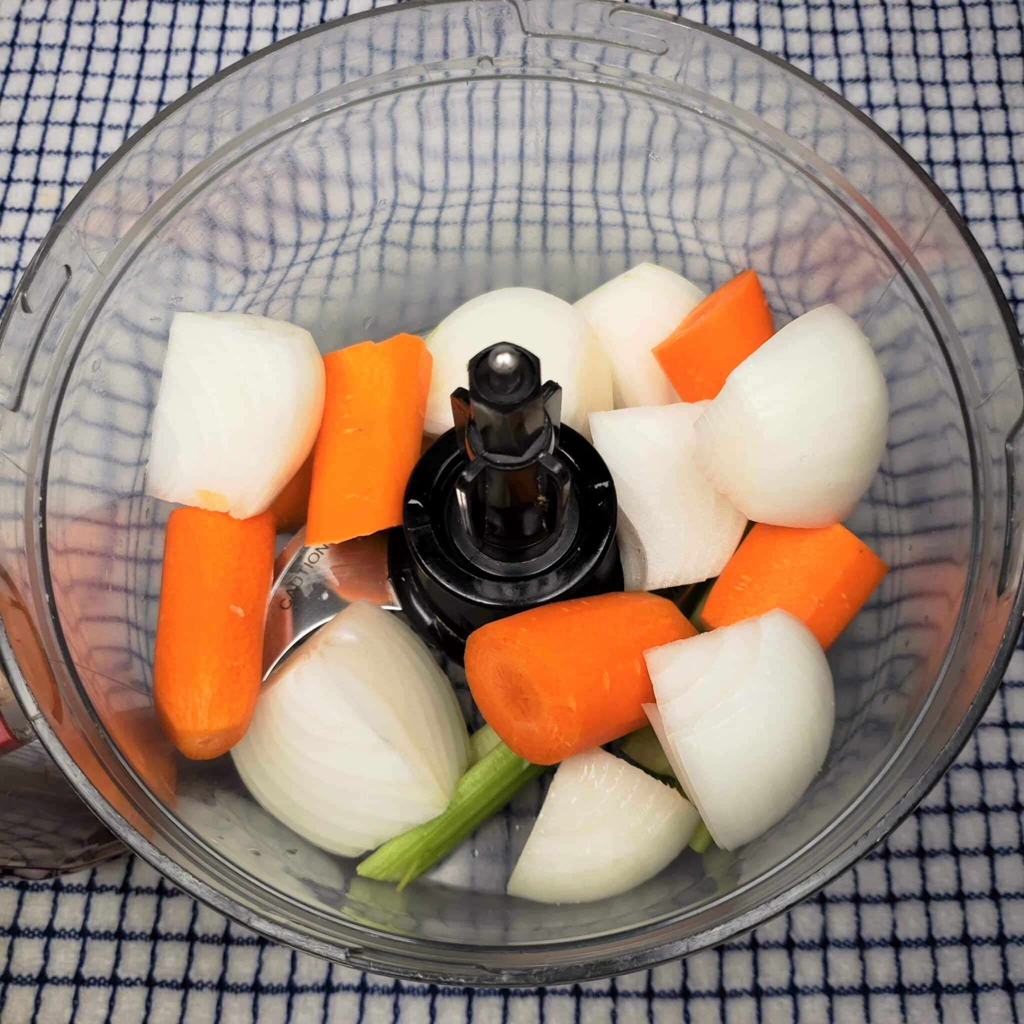 Process onions, carrots and celery in food processor