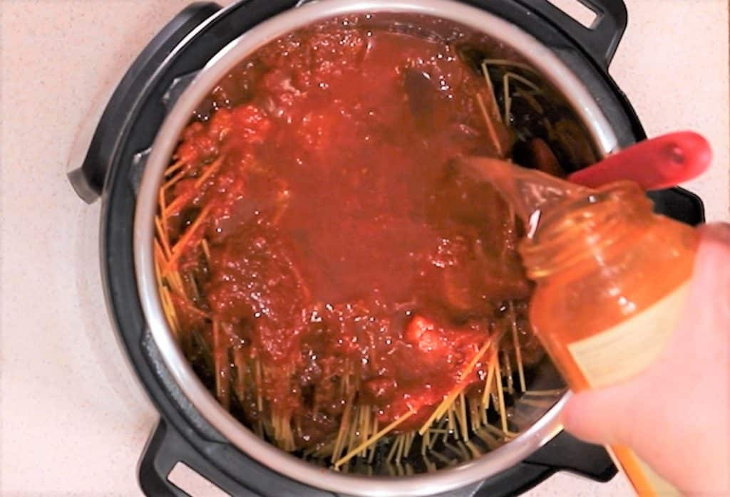 Fill Jar of Spaghetti Sauce with Water and Pour into Cooking Pot