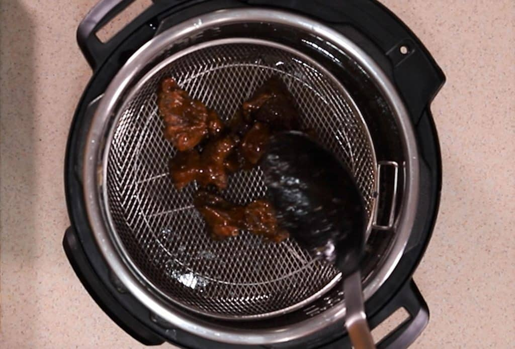 The Burnt Ends are placed into the crisplid basket and cooked at a low temperature.