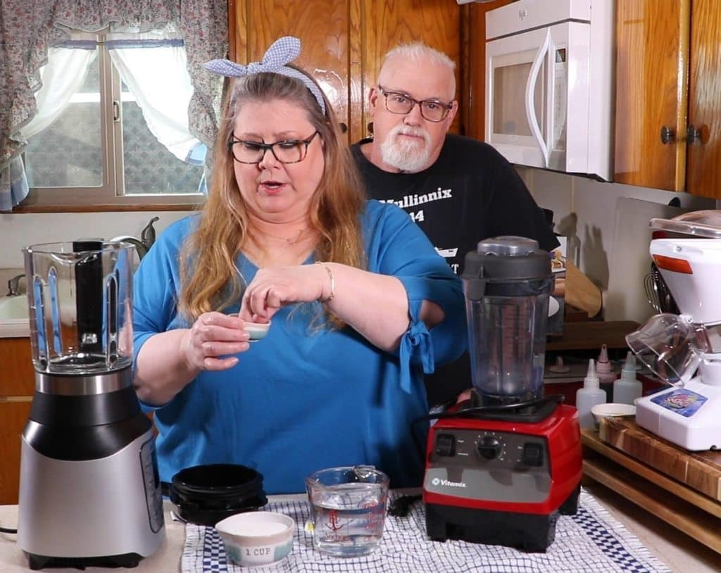 Jill adding a Sprinkling of Xanthan Gum to Instant Pot Ace