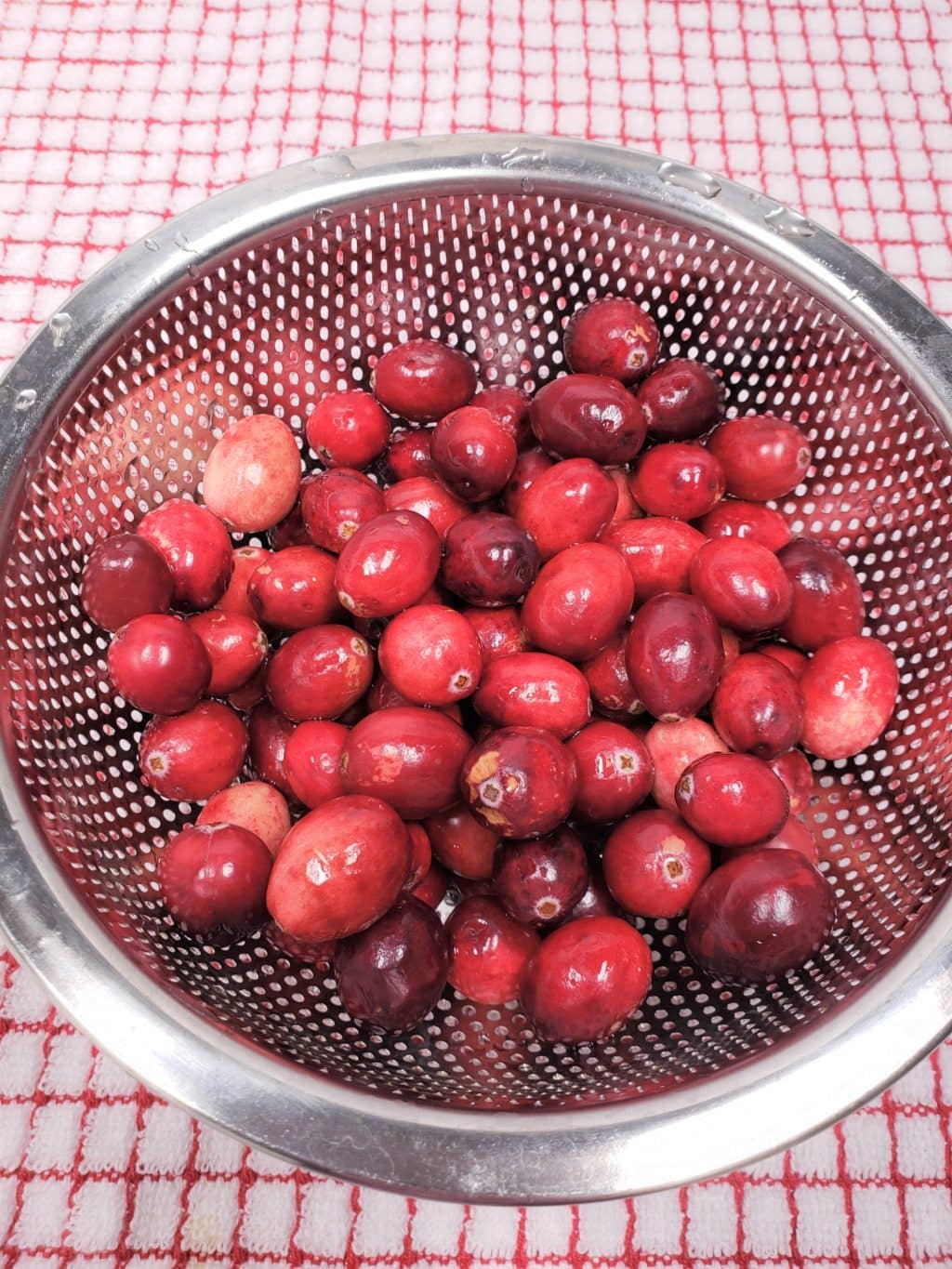 Rinse Raw Cranberries with Water