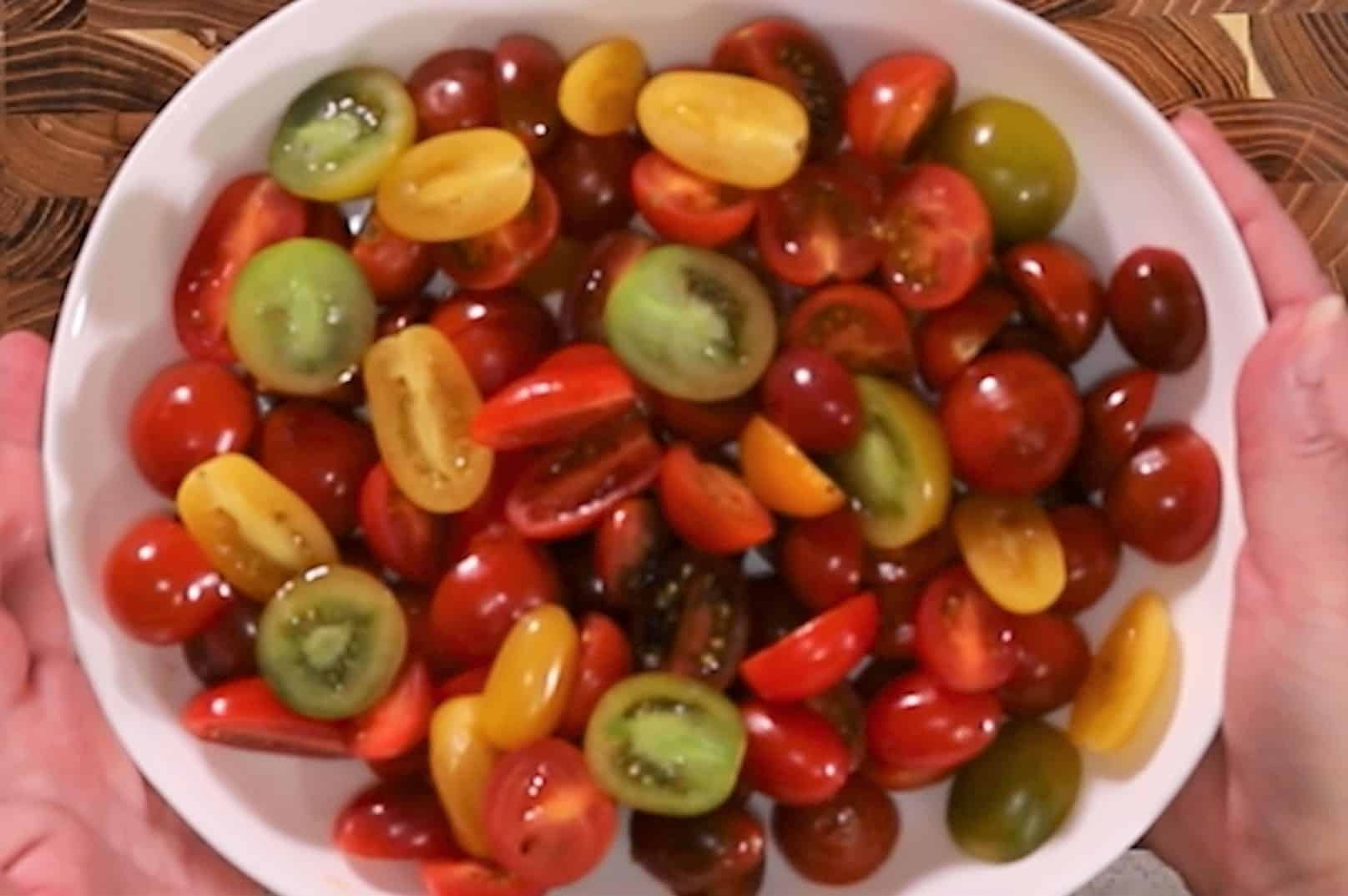 White serving bowl with sliced grape tomatoes