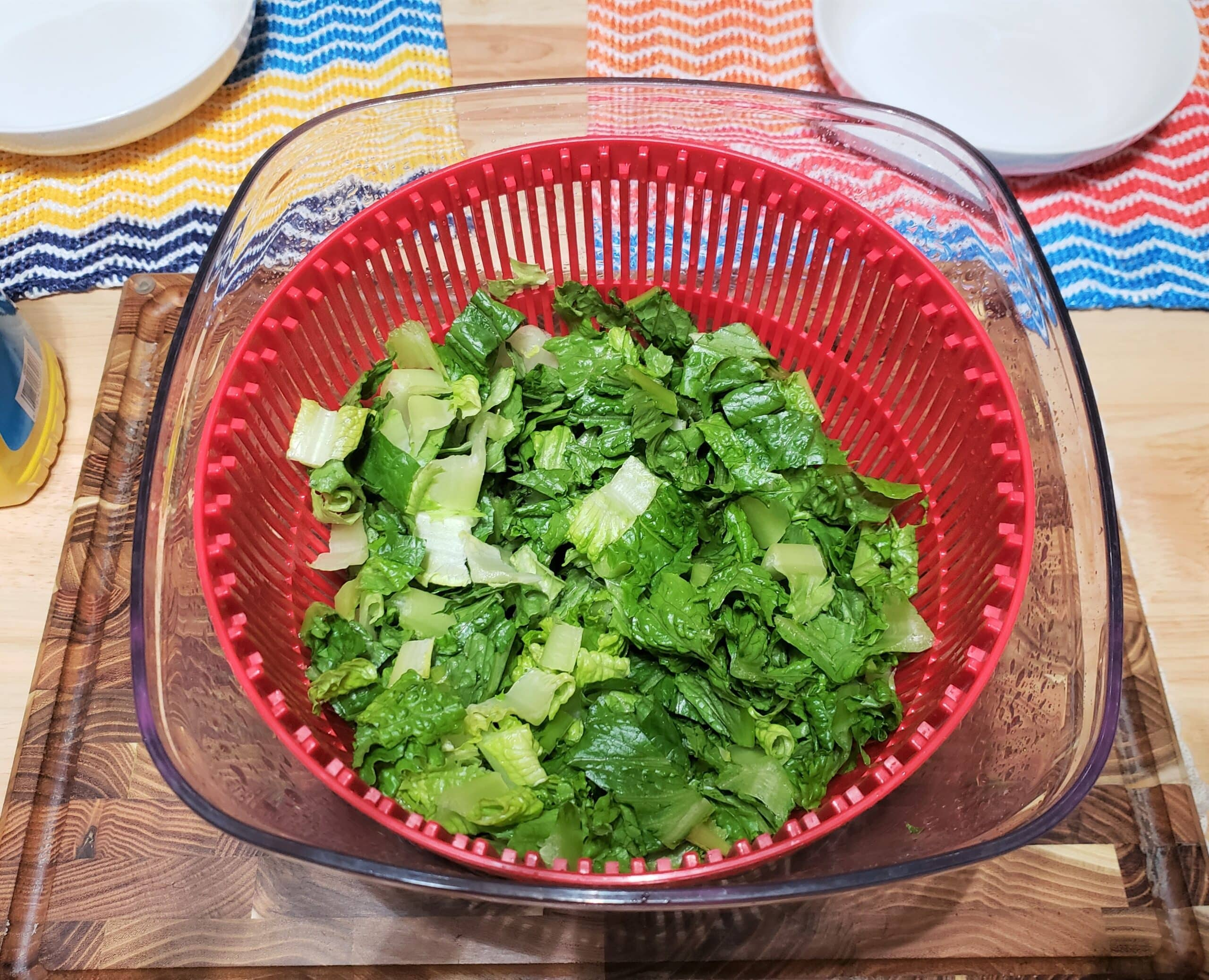 Chopped lettuce in red salad spinner